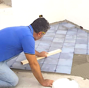 Craftsman installing terrace tile in Sambuca